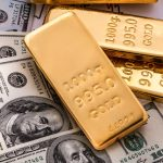 gold-laying-on-money